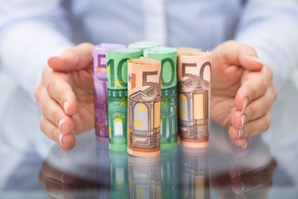 Hand Protecting Rolled Up Euro Banknote © apops - Fotolia